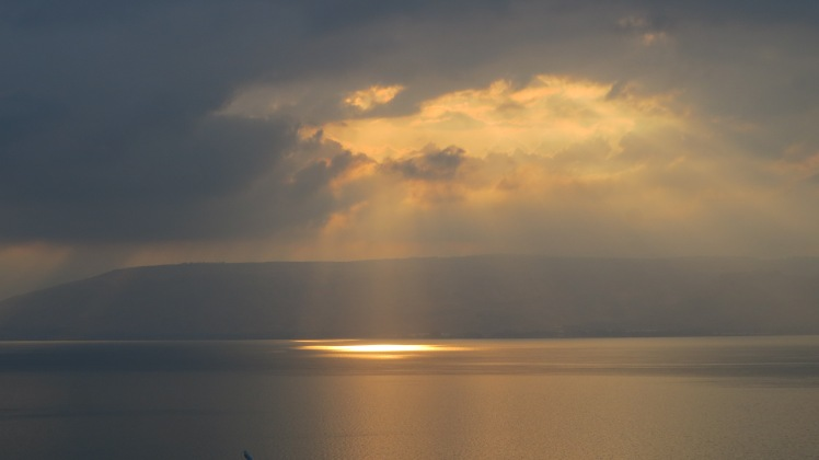 A heavenly light shines upon the Sea of Galilee.
